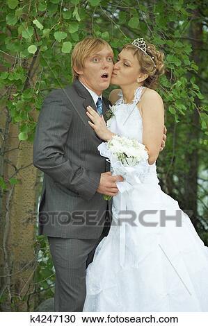 Amusing Groom And Bride Kiss Secretly Stock Image K4247130