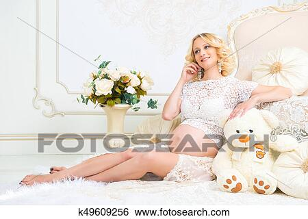 Outstanding Young Pregnant Girl Sitting Near White Sofa With Teddy Bear Squirreltailoven Fun Painted Chair Ideas Images Squirreltailovenorg