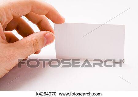 Stock photography of male hand holding blank business card k4264970 male hand holding blank business card over white colourmoves