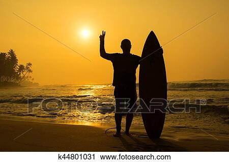 39227d03da Stock Photography - Surfing at Sunset. Fotosearch - Search Stock Photos