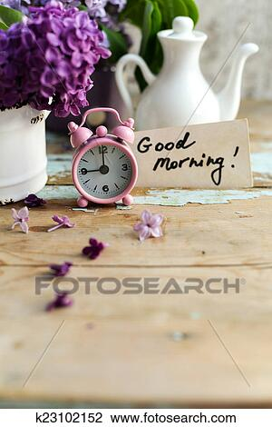 stock photo of two tone lilac flowers with good morning note