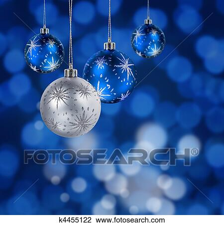 blue and silver christmas balls hanging against blue light spots background - Blue Christmas Balls