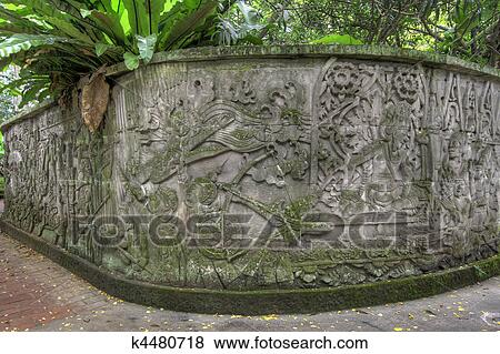 Balinese stone wall carvings stock photo k fotosearch