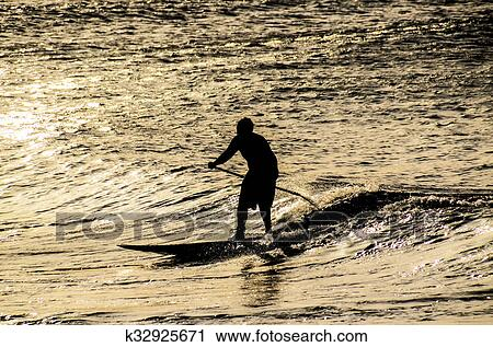 fe669b5a36 Stock Photography of Silhouette Surfer at Sunset k32925671 - Search ...