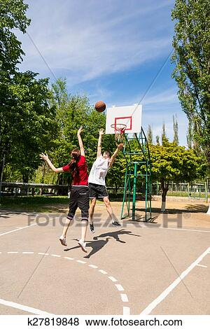 Pictures Of Couple Playing Basketball On Outdoor Court K27819848