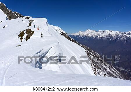 Snowboarders walking uphill for freeride Stock Image ...
