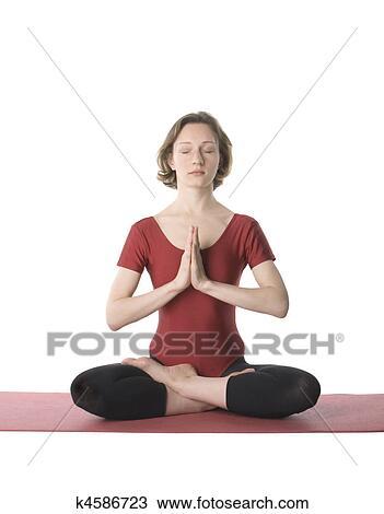 woman in lotus pose stock image  k4586723  fotosearch
