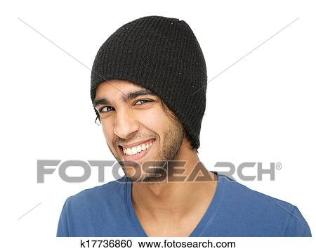 1fad1946893 Close up portrait of a funny young man smiling with black hat isolated on  white background