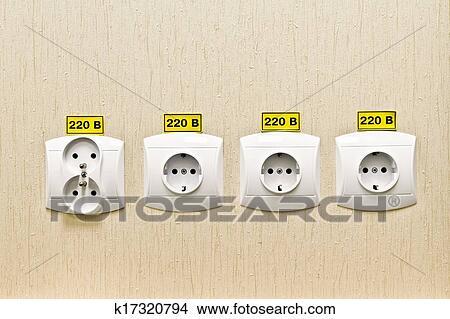 stock foto stecker steckdose 220 volt auf wand von. Black Bedroom Furniture Sets. Home Design Ideas