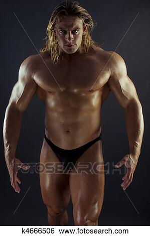 Muscular Man Stock Photograph K4666506 Fotosearch Hey girl, there are better places to see this man's perfect physique, but we prefer it decorated with tattoos (and cash) in the recent indie a place. muscular man stock photograph