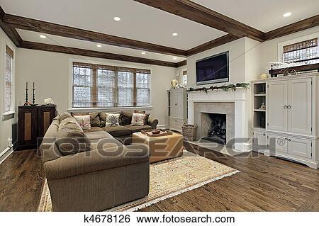 Stock afbeeldingen familie kamer met hout plafond balken