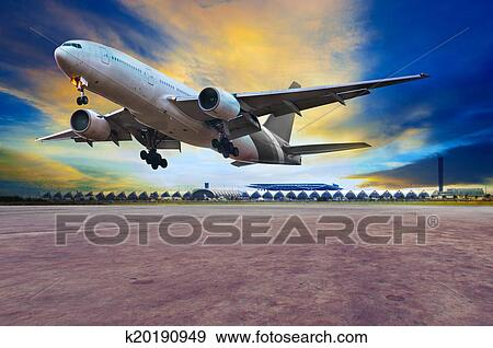 Passenger jet plane landing on air port runways against beautiful dusky sky  use for travel business and air transport, cargo logistid service industy
