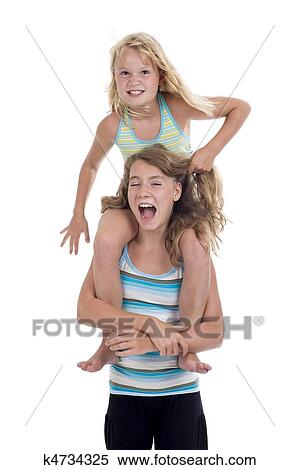 Stock Image Naughty Sisters Having Fun Fotosearch Search Stock Photos Mural Pictures