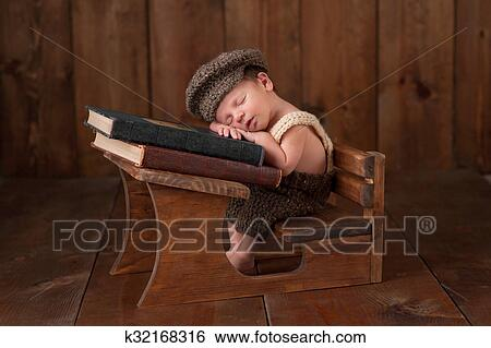 stock images of newborn baby boy sleeping at his school desk