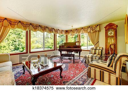 Bright Living Room With Old Fashioned Couch And Chairs Wooden Coffee Table Grand Piano Antique Oak Grandfather Clock