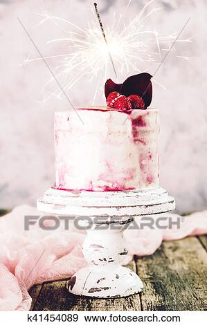 Birthday Cake With Sparkler On Wooden Vintage Table