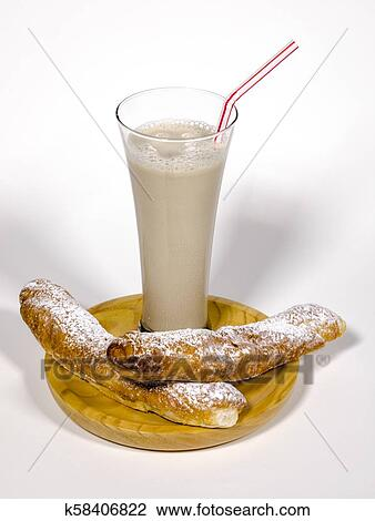 stock photo of horchata and fartons a traditional spanish snack