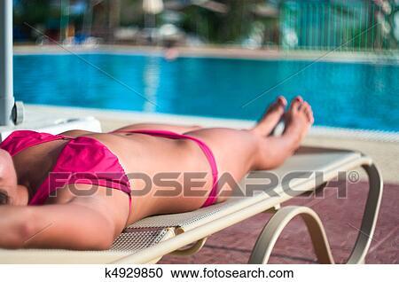 Swimming in a bikini, young teen and mature couple