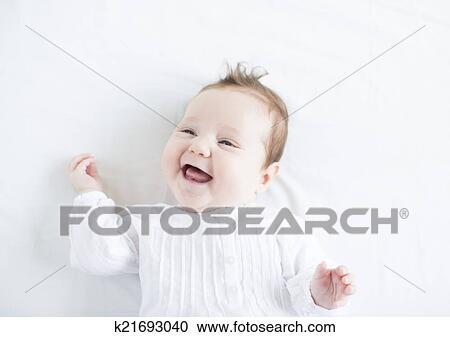 Stock fotografie schattige baby meisje in een witte kleding