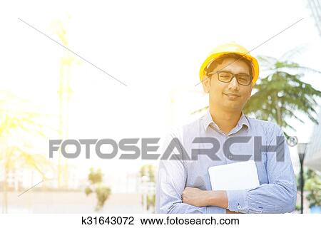 4a03822e258 Stock Photo - Asian Indian male contractor engineer portrait. Fotosearch -  Search Stock Photography