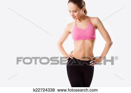 3fb27afee Stock Photo - Young beautiful woman posing in a gym outfit.. Fotosearch