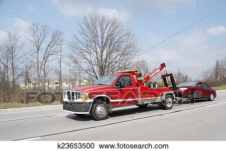 stock illustrations of red tow truck towing car k23653500 search