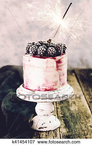 Astounding Birthday Cake With Sparkler On Wooden Vintage Table Stock Photo Funny Birthday Cards Online Inifodamsfinfo