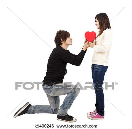 Asian Young Man Handing Over Love Gift To Woman On Valentine Day Isolated White Background