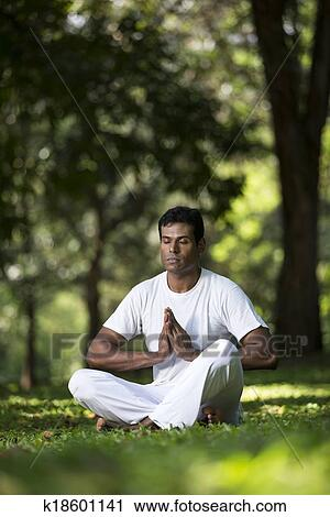 Indian Man Doing Yoga Exercise In A Forest Stock Image K18601141 Fotosearch