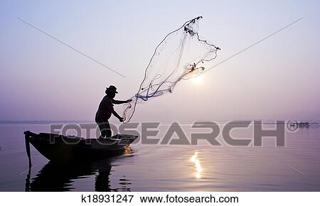 Picture Of Fishermen Are Catching Fish With A Cast Net K18931247