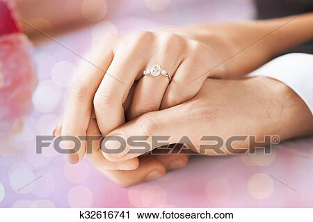 Stock Photography Of Close Up Of Couple Hands With Engagement Ring