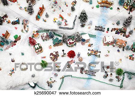 Miniature Christmas Village.Miniature Christmas Village Under Xmas Tree Stock Photo