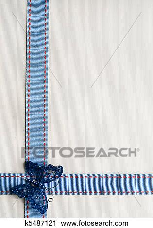 Stock Photography Of Textured Ribbon Over Cream Paper With