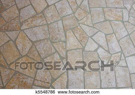 A Patio Of Flat Stones And Mortar For Background And Texture