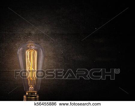 Vintage Edison Light Bulb On Dark Background Stock Photograph K56455886 Fotosearch