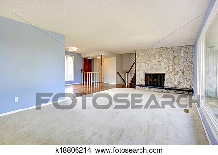 Empty Beautiful Living Room With A Rocky Background Fireplace Picture K18806214 Fotosearch