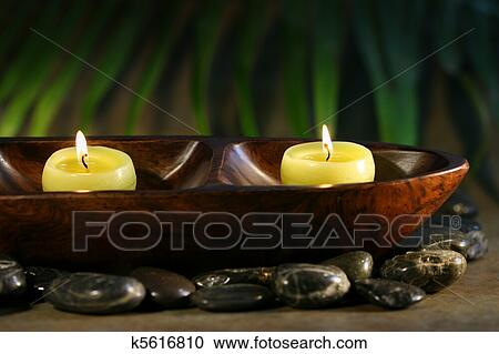 stock photography of massage stones and spa candles k5616810