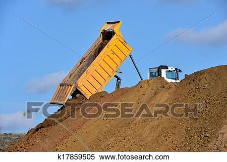 Stock Image Of Dump Truck Unloading Soil During Road Works K17859505