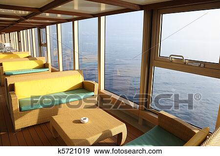 Room For Rest With Sofas And Tables Near Window In Cruise Liner