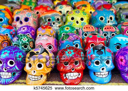 stock image of aztec skulls mexican day of the dead colorful