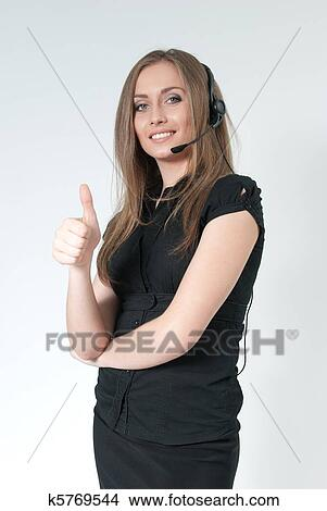 Happy Smiling Attractive Call Center Operator Sexy Girl Wearing Headset Showing Big Finger Super Sign One Of A Series