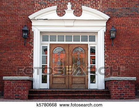 Antique double leaded glass doors on an old brick building - Pictures Of Antique Double Leaded Glass Doors K5780668 - Search