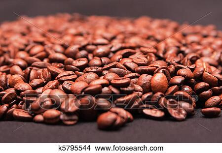 Handful Of Coffee Beans Picture K5795544 Fotosearch