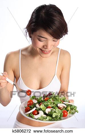 Stock Photo Of Happy Japanese Girl Eating Green Sa