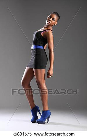Stock Image Of Girl In Black Dress And Blue Heels K5831575 Search