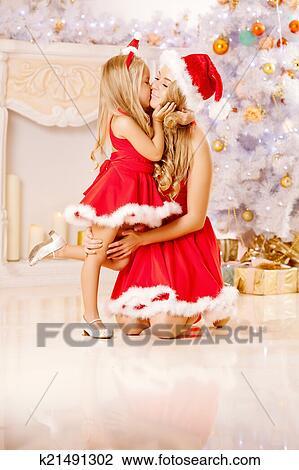 Mother Christmas.Mom And Daughter Dressed As Santa Celebrate Christmas Family At Standartiniai Vaizdai
