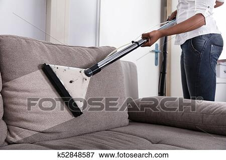 Picture Of Housewife Cleaning Sofa With Vacuum Cleaner K52848587