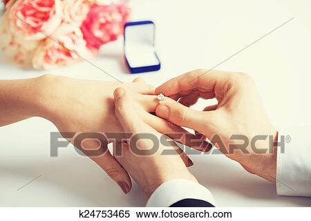 Man Putting Wedding Ring On Woman Hand Stock Image