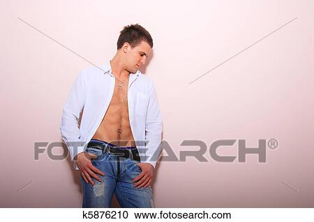 c853595d Young man with unbuttoned shirt Stock Image | k5876210 | Fotosearch