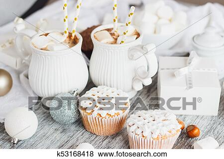 Cups With Cacao And Marshmallow Cupcakes And Different Christmas Decorations Wooden Background Stock Photo K53168418 Fotosearch